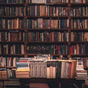shelves filled with variety of books