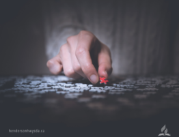 hand with red puzzle piece