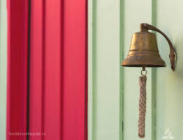bronze bell mounted on wall