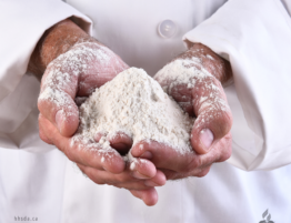 hands filled with flour