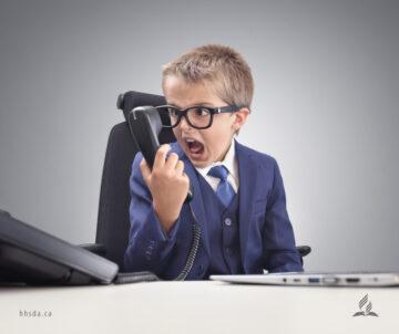 child yelling into phone