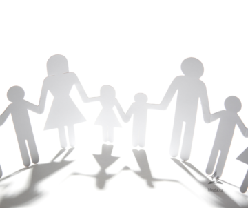 silhouettes of people holding hands